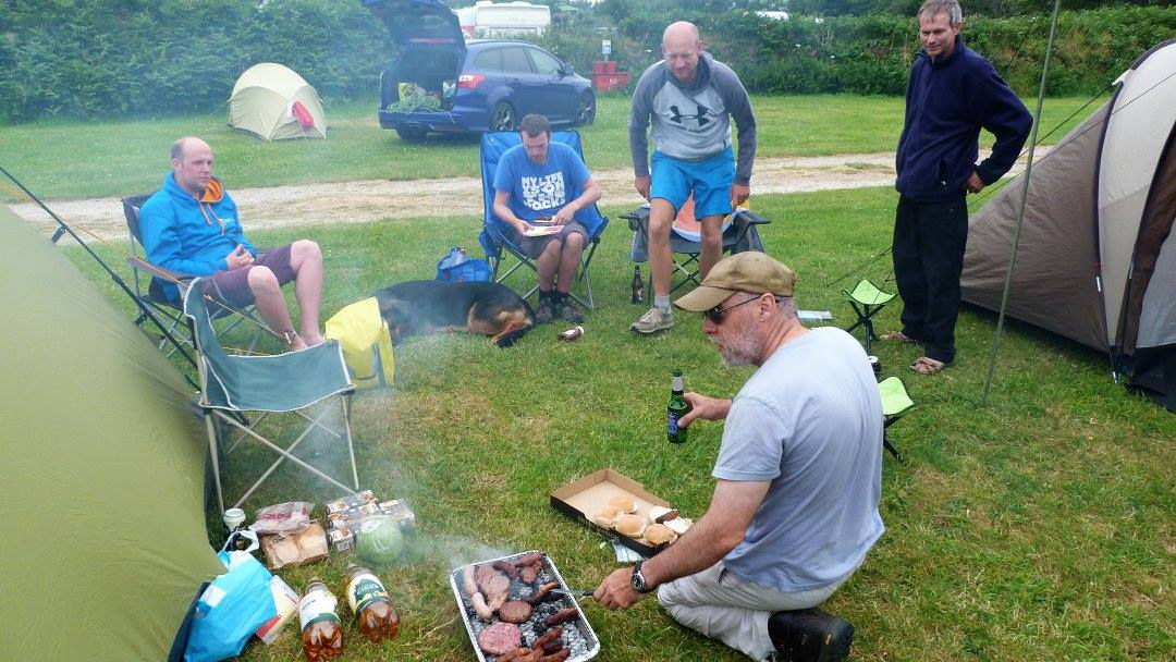 Cooking a campsite meal after a day of climbing in Cornwall.